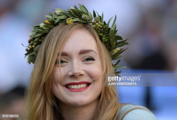 A supporter attends the Russia 2018 World Cup Group D football match between Argentina and Iceland at the Spartak Stadium in Moscow on June 16 2018 /...