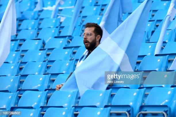 A supporter awaits kick off prior to the Premier League match between Manchester City and Southampton FC at Etihad Stadium on November 4 2018 in...