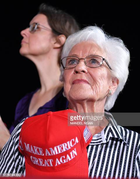 Supporter awaits the arrival of US President Donald Trump for a campaign rally at Pensacola International Airport in Pensacola, Florida on October...