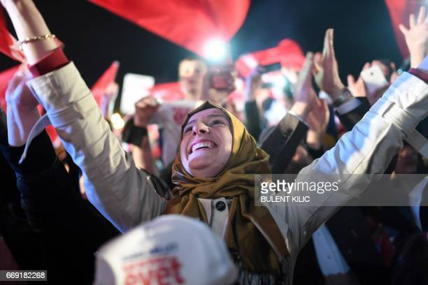 A supporter celebrates and greets Turkish president while he delivers a speech at the conservative Justice and Development Party headquarters in...