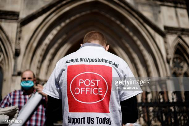 Supporter celebrates outside the Royal Courts of Justice in London, on April 23 following a court ruling clearing subpostmasters of convictions for...