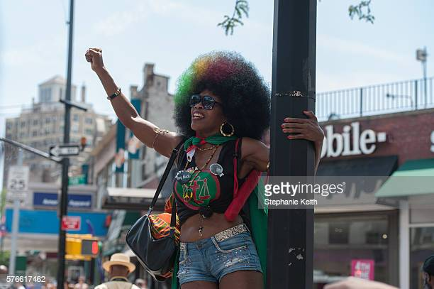 A supporter chants on the sidelines of a march commemorating the two year anniversary of Eric Garner's death on July 16 2016 in the Brooklyn borough...
