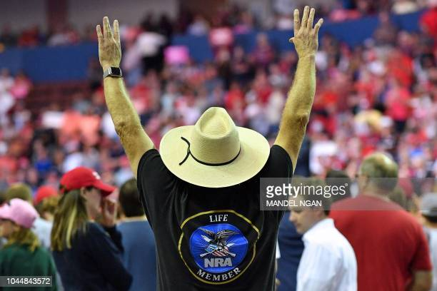 A supporter cheers as US President Donald Trump speaks during a Make America Great Again rally at Landers Center in Southaven Mississippi on October...