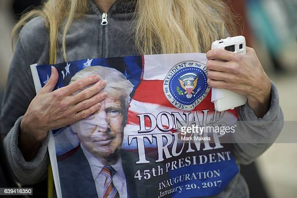 A supporter clutches a Donald Trump themed flag after he was sworn in as the 45th President of the United States on the National Mall January 20 2017...