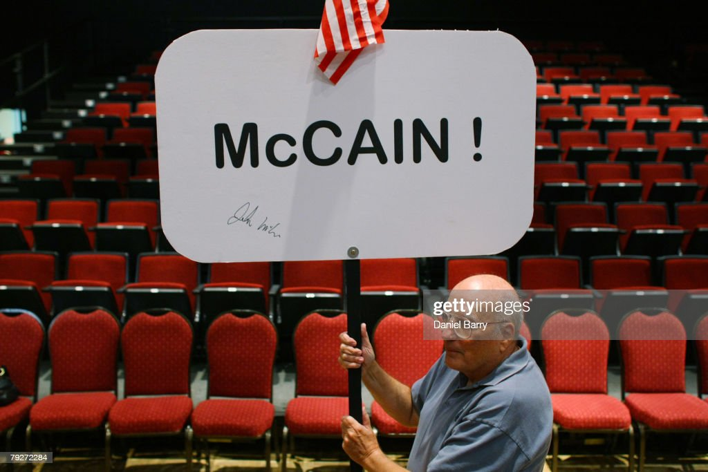 Supporter David Brown holds a sign after Republican presidential hopeful Sen. John McCain (R-AZ) spoke at a campaign stop January 26, 2008 in Sun City Center, Florida. Republican presidential candidates continue to campaign in Florida for the upcoming primary.