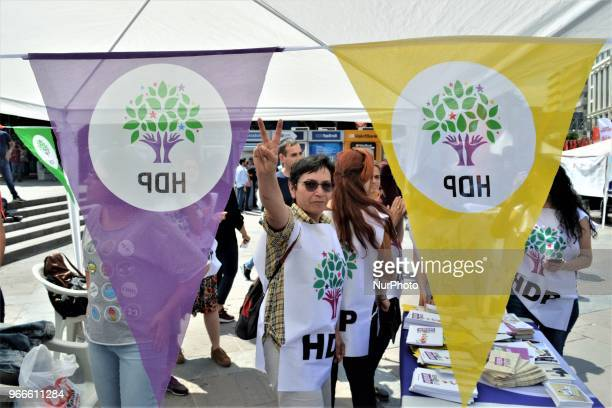 A supporter flashes a victory sign during the opening of a new election campaign booth of the proKurdish Peoples' Democractic Party for the early...