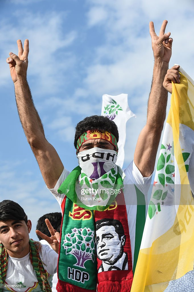 A supporter flashes V sign of Turkey's pro-Kurdish People's Democtratic Party (HDP) leader Selahattin Demirtas as he addresses a rally ahead of the June 7 general elections on May 30, 2015 in Istanbul, Turkey. Turkey will hold general election on June 7, 2015. Although it is a relatively small party, all eyes will be on HDP. If it reaches the minimum 10 percent threshold required for entering parliament as a party, it could effectively thwart Turkey's President Recep Tayyip Erdogans ambition to lead a presidential system following a constitutional change.