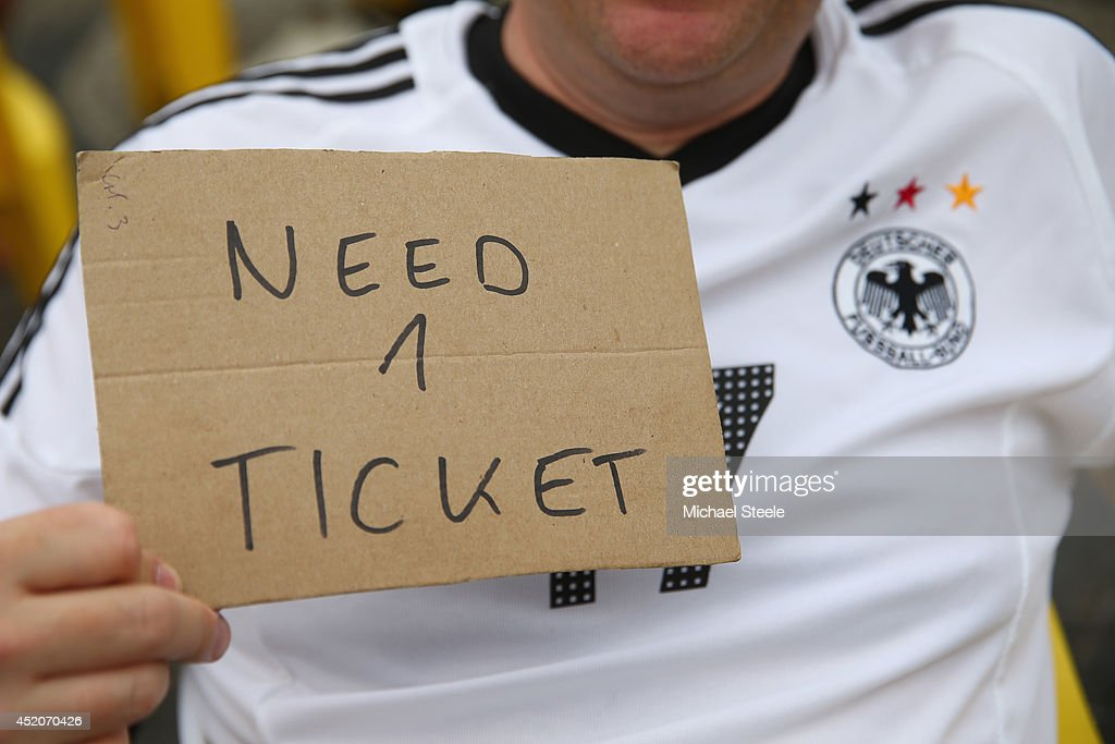 A supporter football supporterof Germany searches for match tickets alongside Copacabana Beach ahead of the 2014 FIFA World Cup Brazil Final match on July 12, 2014 in Rio de Janeiro, Brazil.