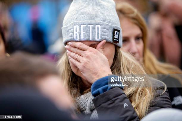 Supporter for Democratic presidential candidate and former Rep. Beto O'Rourke holds her face after O'Rourke announced he was dropping out of the...