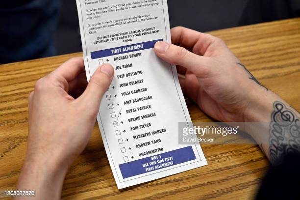 A supporter for Democratic presidential candidate Sen Bernie Sanders holds his ballot during a a Nevada Democratic caucus at Coronado High School on...