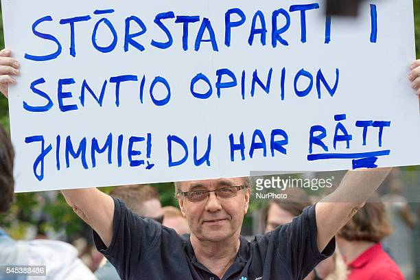 A supporter for Jimmy Åkesson leader of the nationalist Sweden Democrats holds a sign reading quotthe largest party in Sentio opinion poll Jimmie you...
