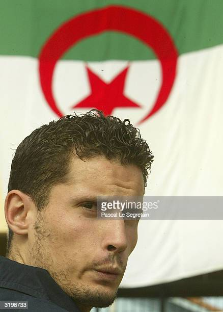 A supporter for Opposition candidate Said Saadi of the Rally for Culture and Democracy Party is seen during a rally April 2 2004 in TiziOuzou Algeria...