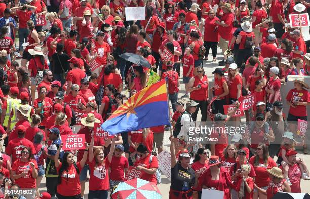 A supporter for the #REDforED movement waves an Arizona flag as thousands of teachers stage a rally outside of the State Capitol on April 26 2018 in...