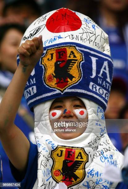 Supporter from Japan cheers prior to the group F match of 2006 FIFA World Cup between Japan and Brazil in Dortmund on Thursday 22 June 2006 DPA/FELIX...