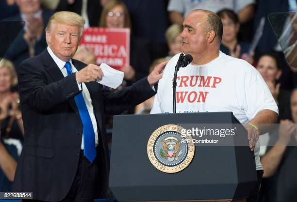 Supporter Geno DiFabio speaks alongside US President Donald Trump during a Make America Great Again rally at the Covelli Centre in Youngstown Ohio...