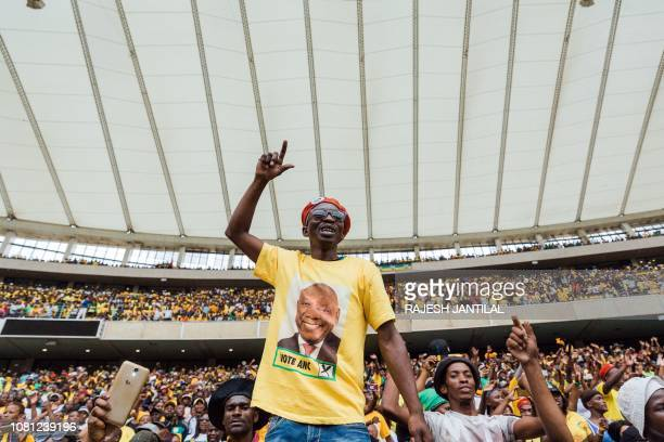 A supporter gestures as President Cyril Ramaphosa arrives at at the African National Congress 107th anniversary celebrations at the Moses Mabhida...