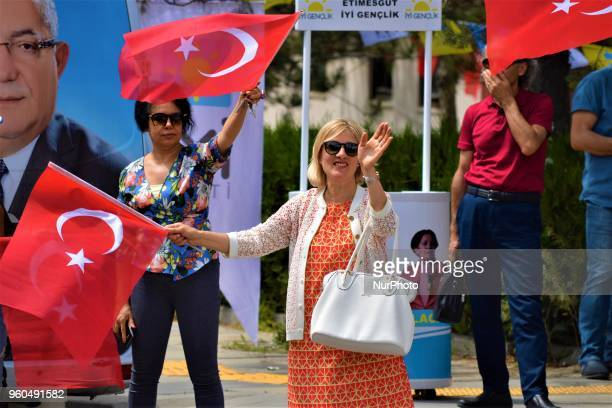 A supporter holding a Turkish flag waves her hand during a rally in support of Meral Aksener presidential candidate and the leader of the opposition...
