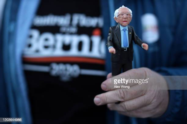 A supporter holds a Bernie action figure outside a campaign event of Democratic presidential candidate Sen Bernie Sanders at Ingersoll Tap February 2...
