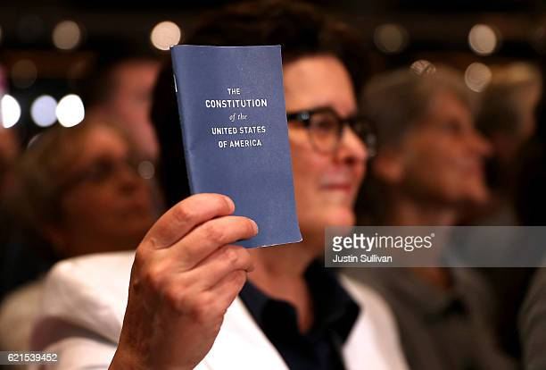 A supporter holds a copy of the US Constitution during a campaign rally with Democratic presidential nominee former Secretary of State Hillary...
