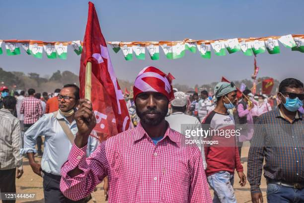 Supporter holds a flag during the mega rally. The Communist party CPIM launches a mega rally with its allies the Congress and The Indian Secular...