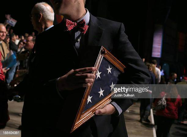 A supporter holds a flag that survived the Space Shuttle Challenger crash during a campaign rally for Republican presidential candidate former...