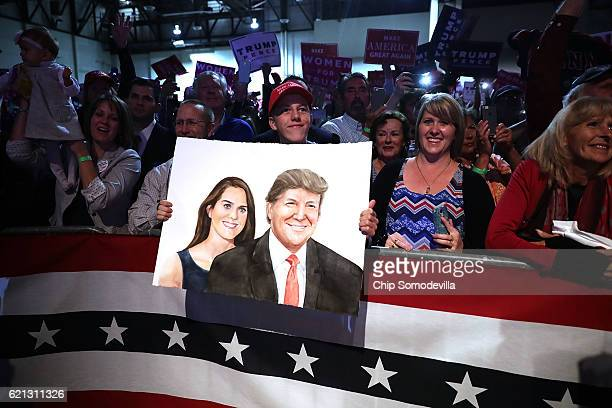 A supporter holds a painting of Republican presidential nominee Donald Trump during a campaign rally the RenoSparks Convention Center November 5 2016...