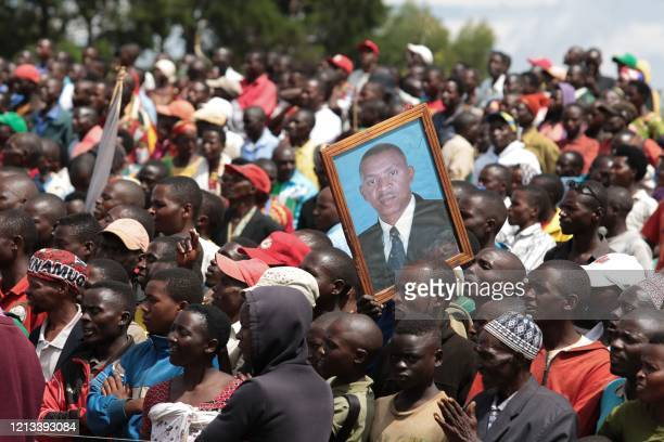 TOPSHOT A supporter holds a picture of Agathon Rwasa presidential candidate of the main opposition party the National Congress for Liberty during the...