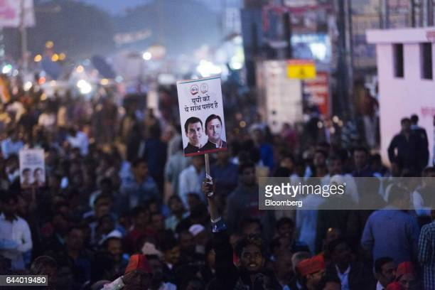 A supporter holds a placard featuring images of Akhilesh Yadav chief minister of the state of Uttar Pradesh and president of the Samajwadi Party...