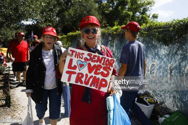 A supporter holds a placard reading 'This Senior Loves Trump' at a rally at the Amway Center in Orlando Florida United States on June 18 2019...