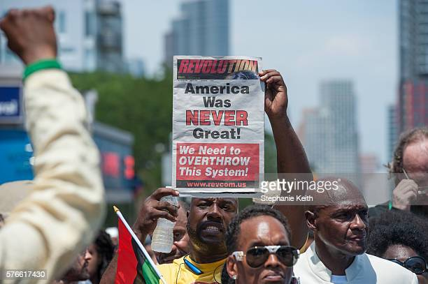 A supporter holds a sign during a march commemorating the two year anniversary of Eric Garner's death on July 16 2016 in the Brooklyn borough of New...