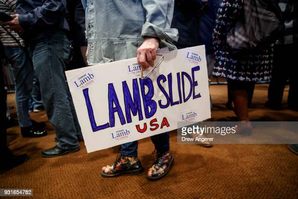 A supporter holds a sign in support of Conor Lamb Democratic congressional candidate for Pennsylvania's 18th district at an election night event for...