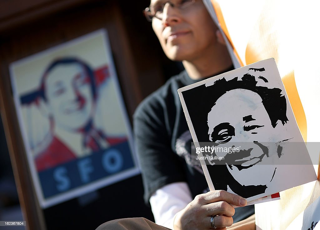 A supporter holds a sign with the image of slain San Francisco supervisor Harvey Milk during a rally at San Francisco City Hall on February 22, 2013 in San Francisco, California. Dozens of supporters staged a rally in front of San Francisco City Hall to support San Francisco supervisor David Campos's Harvey Milk SFO charter amendment that aims to change the name of the San Francisco International Airport to Harvey Milk SFO in honor of the Milk who was the first openly gay elected official in the United States. Milk was assassinated on November 27, 1978 along with then San Francisco Mayor George Moscone by Dan White, a San Francisco supervisor who had recently resigned.