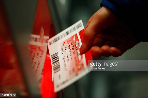 A supporter holds a ticket before the Barclays Premier League match between Arsenal and Southampton at Emirates Stadium on December 3 2014 in London...