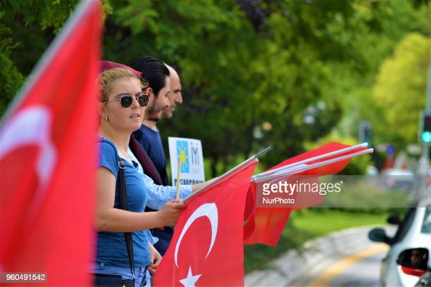 A supporter holds a Turkish flag during a rally in support of Meral Aksener presidential candidate and the leader of the opposition IYI Party in...