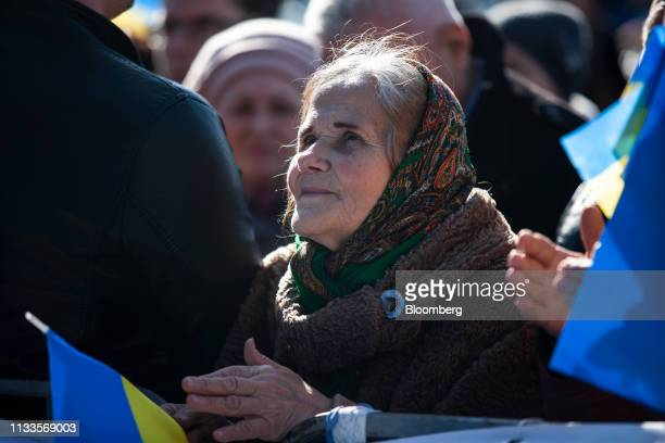 A supporter holds a Ukrainian flag during a political rally for Yulia Tymoshenko former Prime Minister not pictured in Kiev Ukraine on Friday March...