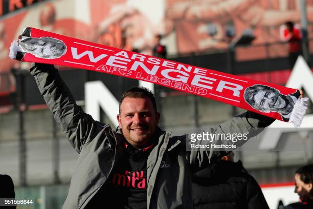A supporter holds an Arsene Wenger scarf prior to the UEFA Europa League Semi Final leg one match between Arsenal FC and Atletico Madrid at Emirates...