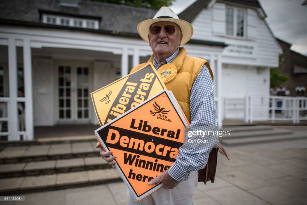 A supporter holds placard as former Liberal Democrat Secretary of State for Business, Innovation and Skills, Vince Cable, launches his campaign to return to parliament where he also warned of the risk of a second 'economic storm' caused by a hard Brexit, on April 28, 2017 in Twickenham, England.