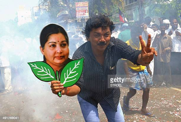 A supporter holds up a placard bearing the portrait of southern Indian state of Tamil Nadu Chief Minister and General Secretary of The All India Anna...