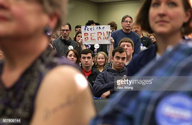 A supporter holds up a sign as Democratic presidential candidate Sen Bernie Sanders speaks to campaign volunteers during an event at Five Sullivan...