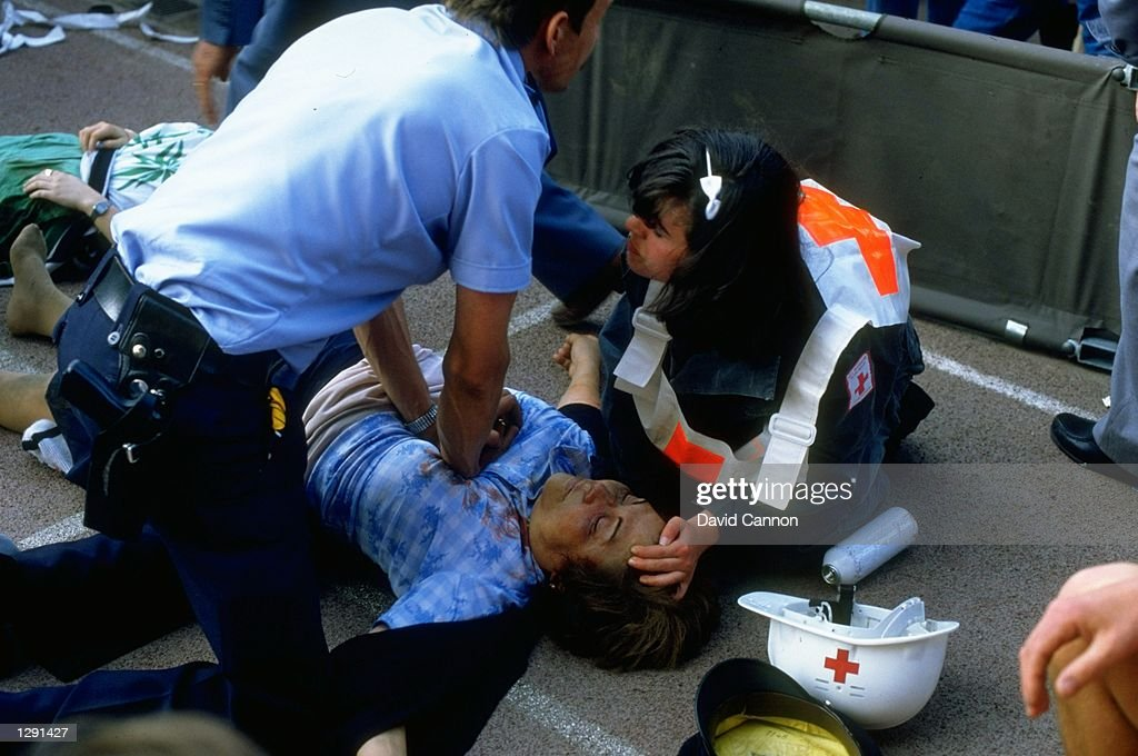 A supporter is given first aid... : News Photo