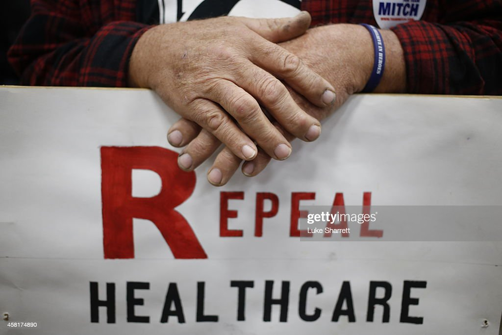 Supporter James Hughes of Louisville, Ky. holds a sign calling for the repeal of the Affordable Care Act during a rally for Senate Minority Leader Mitch McConnell (R-KY) at Brandeis Machinery & Supply Company on October 31, 2014 in Louisville, Kentucky. With less than a week remaining until election day McConnell maintains a slight edge over Democratic challenger Kentucky Secretary of State Alison Lundergan Grimes in recent polls.