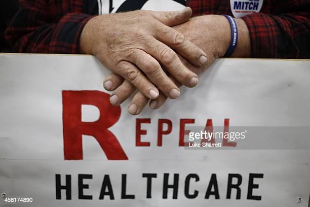 Supporter James Hughes of Louisville Ky holds a sign calling for the repeal of the Affordable Care Act during a rally for Senate Minority Leader...