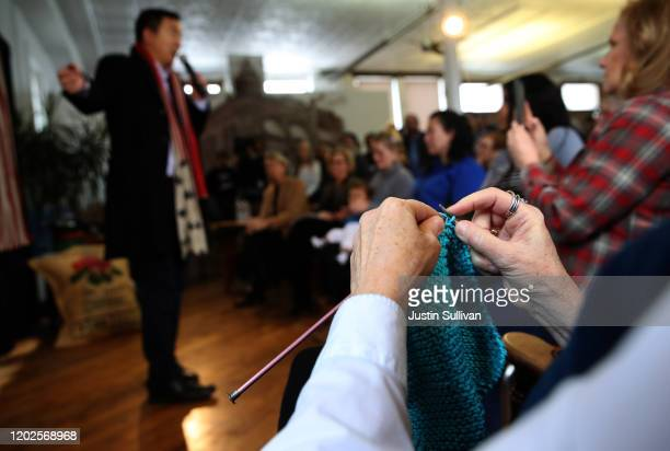 A supporter knits as Democratic presidential candidate Andrew Yang speaks during a campaign event at Perry Perk on January 28 2020 in Perry Iowa With...