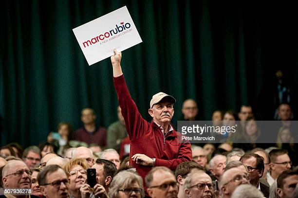 A supporter listens as Republican presidential candidate Sen Marco Rubio addresses voters at a caucus site as Iowans prepare to cast their first...