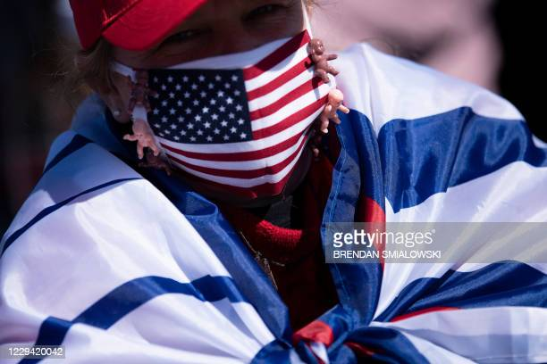 Supporter listens as US President Donald Trump speaks during a Make America Great Again rally at Fayetteville Regional Airport November 2 in...