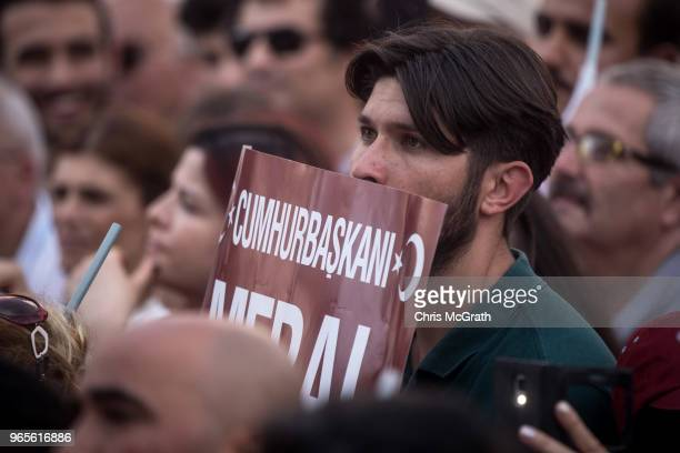 A supporter listens to a speech by leader of Turkey's Iyi Party and presidential candidate Meral Aksener during a rally on June 1 2018 in Antakya...