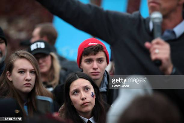 A supporter looks on as Democratic presidential candidate former Rep Beto O'Rourke speaks about dropping out of the presidential race before the...