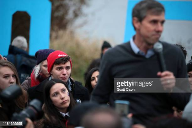 Supporter looks on as Democratic presidential candidate, former Rep. Beto O'Rourke speaks about dropping out of the presidential race before the...