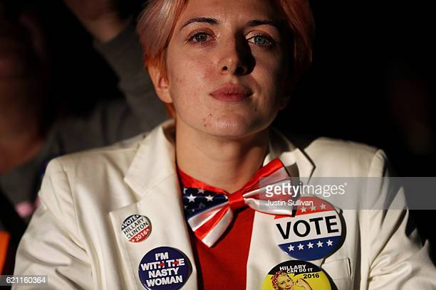 A supporter looks on as Democratic presidential nominee former Secretary of State Hillary Clinton speaks during a campaign rally at Eastern Market on...