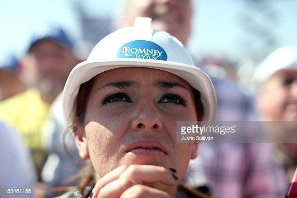 A supporter looks on as Republican presidential candidate former Massachusetts Gov Mitt Romney speaks during a campaign rally on October 5 2012 in...